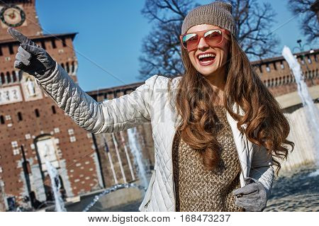 Happy Trendy Woman In Milan, Italy Pointing On Something