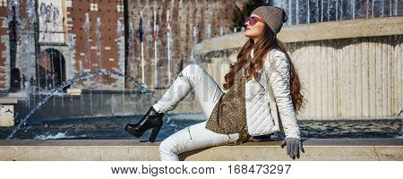 Full Length Portrait Of Tourist Woman In Milan, Italy Relaxing