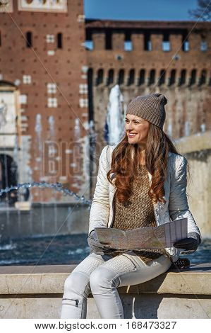 Rediscovering things everybody love in Milan. happy trendy tourist woman near Sforza Castle in Milan Italy having excursion