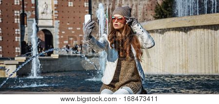 Traveller Woman In Milan, Italy Taking Selfie With Smartphone