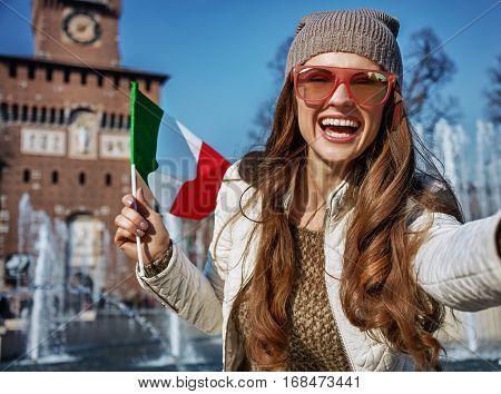 Woman In Milan, Italy With Italian Flag Taking Selfie