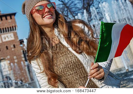 Woman In Milan, Italy With Italian Flag Looking Into Distance