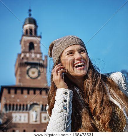 Woman Near Sforza Castle In Milan Speaking On Mobile Phone