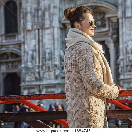 Tourist Woman In Front Of Duomo In Milan Looking Into Distance