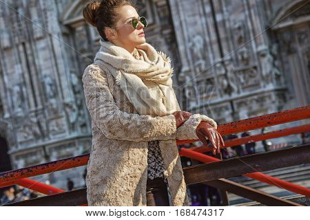 Traveller Woman In Front Of Cathedral Looking Into Distance