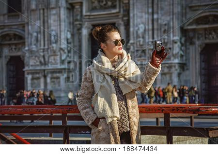 Traveller Woman In Milan With Digital Camera Taking Photo