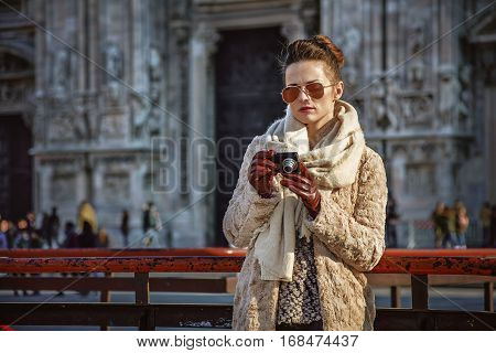 Traveller Woman In Front Of Cathedral Viewing Photos On Camera