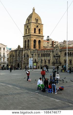 LA PAZ BOLIVIA - MAY 20 2015: People walking near The Basilica of San Francisco. It is located on the Plaza San Francisco in downtown of La Paz. At a height of 3,650 MASL, La Paz is the highest capital in the world