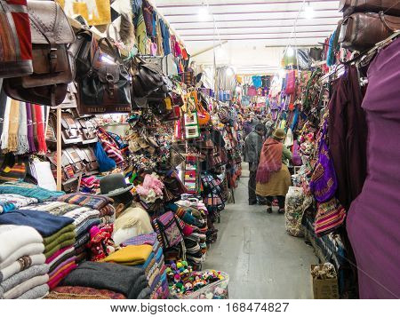 LA PAZ BOLIVIA - MAY 20 2015: Souvenir tourist market on Sagarnaga street in La Paz Bolivia. Predominate handmade products llama wool or sheep. . At a height of 3,650 MASL, La Paz is the highest capital in the world
