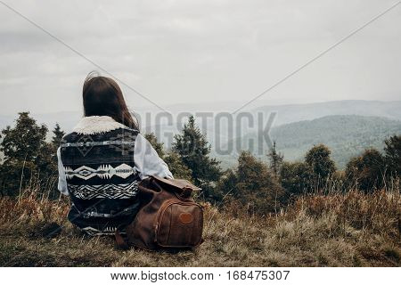 Hipster Traveler With Backpack Relaxing On Top Of Mountains Looking Forward. Wanderlust And Travel C