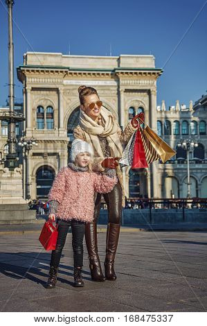 Mother And Child Travellers In Milan Pointing On Something