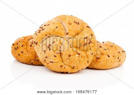 Kaiser roll with sesame seeds on a white background