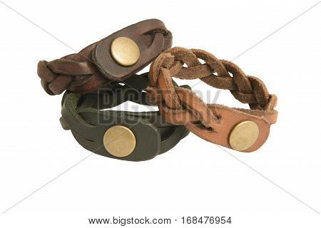Handmade Leather Bracelets. Three handmade leather bracelets isolated against a white background