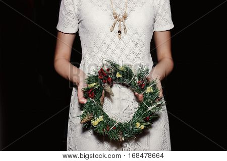 Boho Woman Holding Christmas Wreath In Hands, Seasonal Holidays, Rustic Theme, Adorning