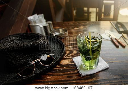 Tasty Mojito On Wooden Table With Hat And Sunglasses At Restraunt, Summer Vacation Concept
