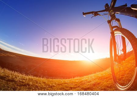 Sunset and sunrise, One cycle on a bright day with beautiful landscape background. Sunset and sunrise. Spring season. Wide angle. Fisheye. Details. Horizon.