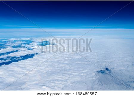 Clouds on a clear day. Top view. clear sky above, a dense layer of Party Committee bottom