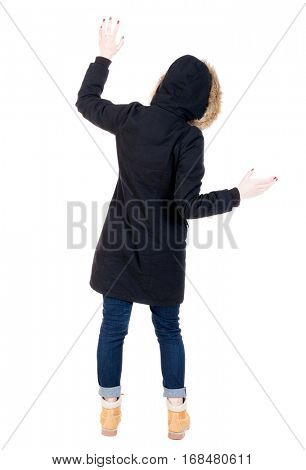 Back view woman in winter jacket  Balances waving his arms.   Standing young girl in parka. Rear view people collection.  backside view of person.  Isolated over white background.