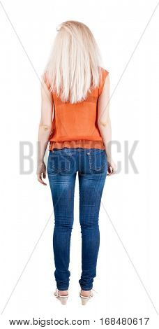 back view of standing young beautiful  blonde woman. she shyly looks at something. girl  watching. Rear view people collection.  backside view of person.  Isolated over white background.