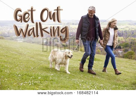 Get Out Walking Couple Taking Dog For Walk