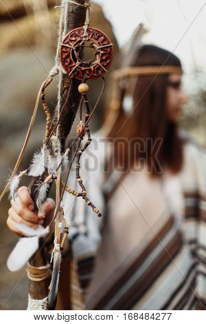Beautiful Native Indian American Woman Holding Pikestaff With Dreamcatcher On Background Of Woods