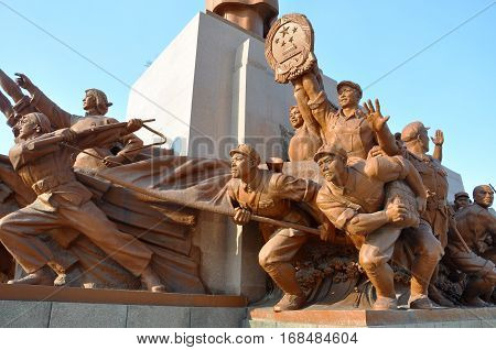SHENYANG, CHINA - JUL. 26, 2012: Cultural Revolution Workers and Soldiers statue under Chairman Mao Statue in Zhongshan Square in downtown, Liaoning Province, China.