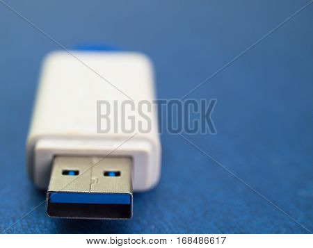 Close up USB flash memory Placed on a blue background.
