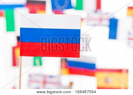 Close-up picture of flag of Russian Federation against European Union member-states flags
