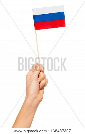 Small paper flag of Russian Federation in woman's hand isolated on white