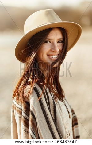 Beautiful Woman Hipster Portrait Smiling, With Romantic Look And Enjoying, Wearing Hat And Poncho, B