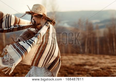 Beautiful Boho Woman Hipster Having Fun, Wearing Hat And Poncho At Sunset In Mountains, True Emotion