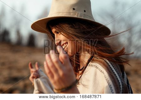 Beautiful Boho Woman Hipster Portrait, Smiling, Wearing Hat And Poncho At Sunset In Mountains, True