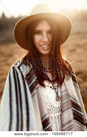 Beautiful Boho Woman Hipster Portrait, Wearing Hat And Poncho,  At Sunset In Mountains,  Sensual Loo