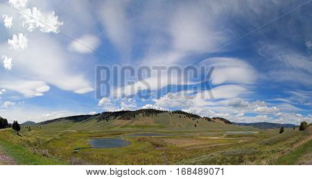 Panoramic view of Blacktail Lakes under cirrus lenticular cloudscape in Yellowstone National Park in Wyoming USA