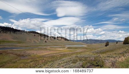 Blacktail Lakes under cirrus lenticular cloudscape in Yellowstone National Park in Wyoming