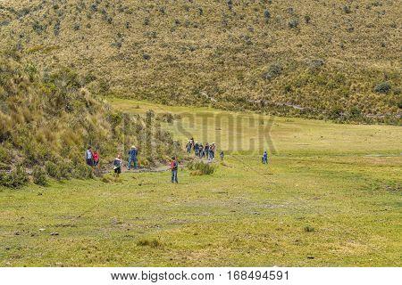 COTOPAXI, ECUADOR, FEBRUARY - 2016 - Group of people trekking a trail at Cotopaxi national park Ecuador