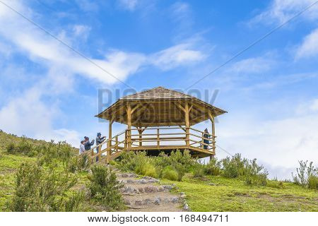 COTOPAXI, ECUADOR, FEBRUARY - 2016 - Low angle view of people at wooden pergola in Cotopaxi national park Ecuador