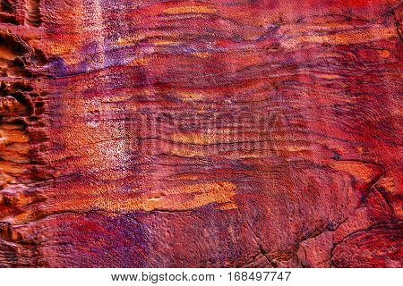 Rose Red Rock Tomb Facade Abstract Street of Facades Petra Jordan. Built by the Nabataens in 200 BC to 400 AD. Rose Red canyon walls create many abstracts close up. Reds are created by magnesium in sandstone.