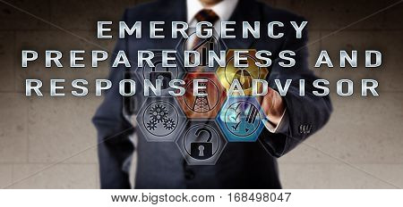 Recruiter in blue suit pushing EMERGENCY PREPAREDNESS AND RESPONSE ADVISOR on an interactive remote control screen. Oil and gas industry job concept for incident command and hazard management.