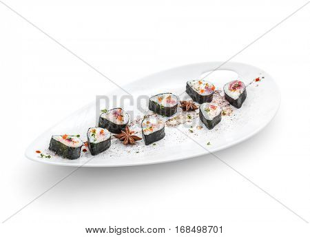 Tasty rolls spiced on white saucer with cinnamon. Clipping path