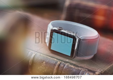Template of smart watch on the antique book. Clipping path