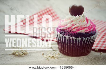 Hello Wednesday words on cup cake background