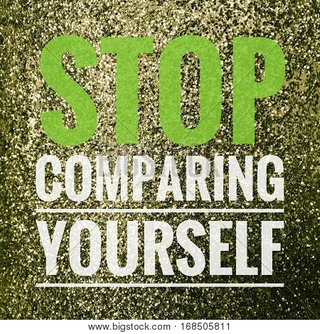Stop comparing yourself motivational quote on shiny glitter background