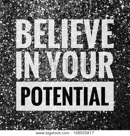 Believe in your potential motivational quote on shiny glitter background