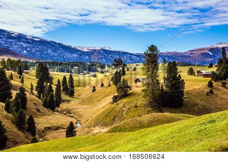 Well-known international ski resort in the fall. Jagged rocks around the Alps di Siusi mountain valley. Concept of active and ecological tourism