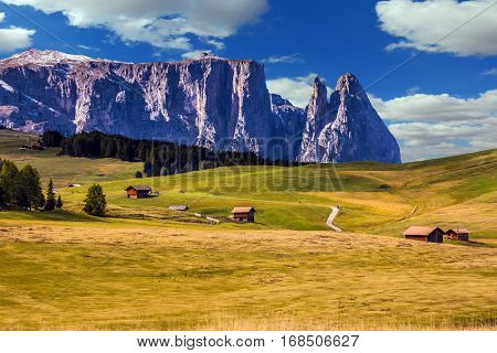 Jagged rocks around the Dolomites. The Alps di Siusi. Well-known international ski resort in the fall. Concept of active and ecological tourism