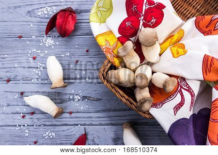 King oyster mushroom Pleurotus eryngii on the gray wooden background. Rustic style