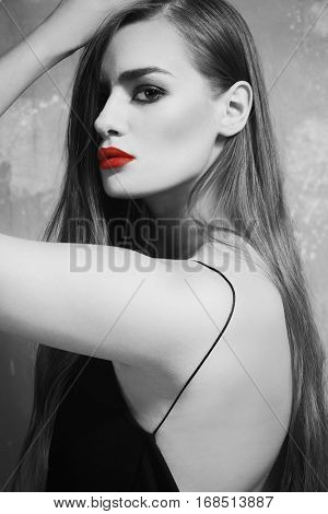Young woman with color accent in makeup on gray background