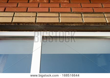 Window Frame And Metal Plinth