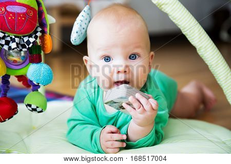 Baby playing with colorful toys and book